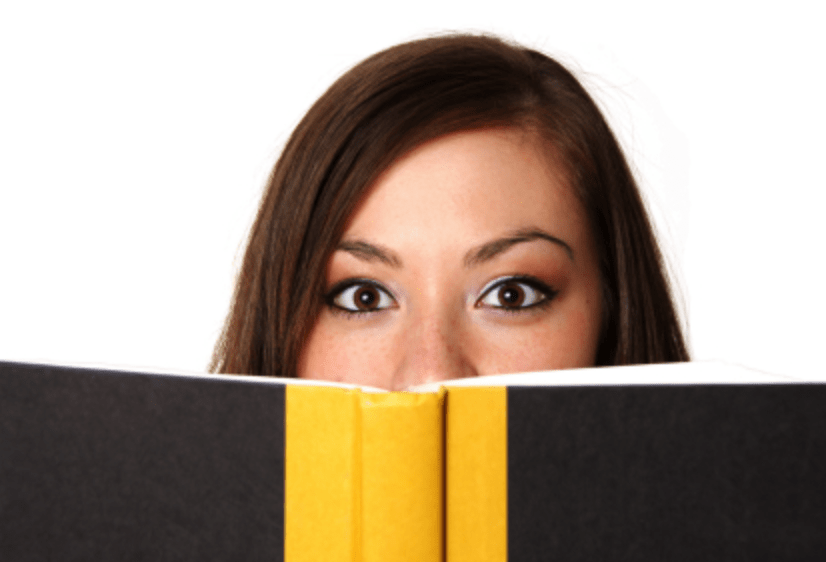 woman peering through book